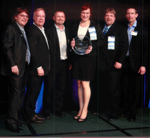 Jim Schnepper GAF Executive VP, Sales,  and Paul Bromfield GAF Senior VP, Marketing, present the 2013 President's Club Award to Chad Muth, Ty Lang, Holly Colley and Kelly Wengerd on behalf of Muth & Company Roofing.